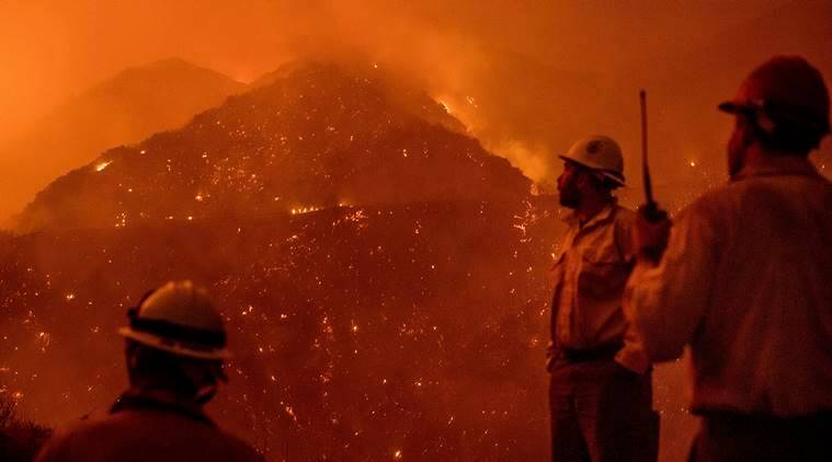 Man killed, firefighters injured as wildfire sweeps through California