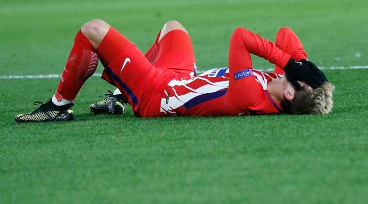 Antoine Griezmann holds his head during the clash with Chelsea.