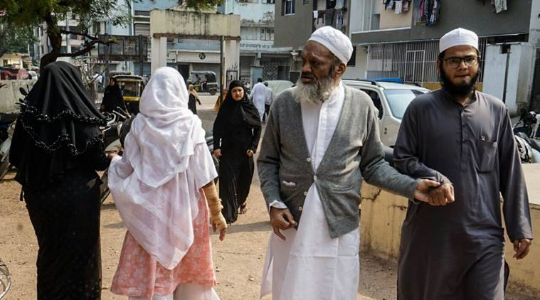 Members of the Muslim community in Gujarat visit polling booths