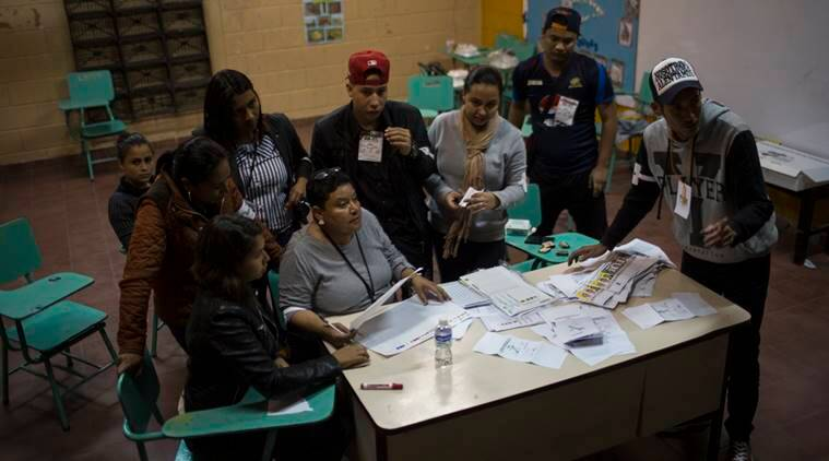 Honduras officials to hand count final votes