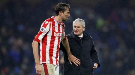 Stoke City's Peter Crouch with manager Mark Hughes