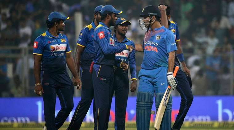 Mahendra Singh Dhoni shakes hands with Sri Lanka team after win in Mumbai
