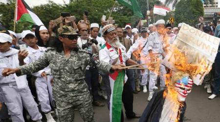 Hardline Indonesian Muslim groups burn US, Israeli flags over Trump's Jerusalem move