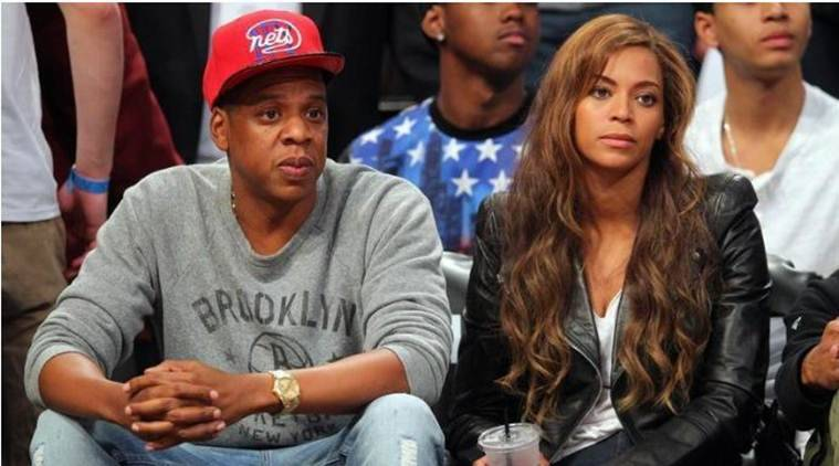 Jay-Z and Beyonce look on during the third quarter of game