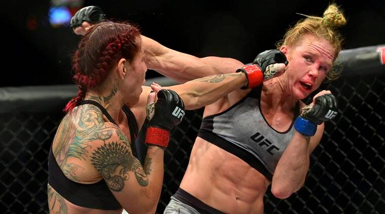 Cris Cyborg lands a hit against Holly Holm