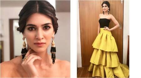 Kriti Sanon glitters in a silk mustard Gauri and Nainika gown at an awards function