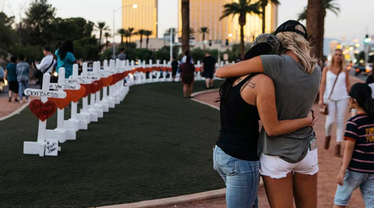 """A memorial displaying 58 crosses by Greg Zanis stands at the """"Welcome To Las Vegas Sign"""" in Las Vegas. Each cross has the name of a victim killed during the mass shooting at the Route 91 Harvest country music festival on October 1, 2017. (Photo: AP)"""
