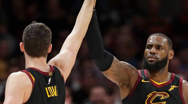 Cleveland Cavaliers' LeBron James is congratulated by Kevin Love