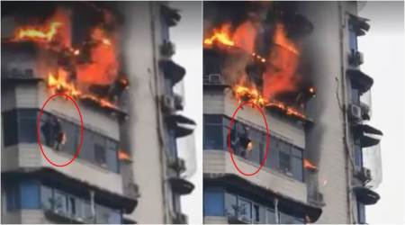 VIDEO: Man's narrow brush with death as he miraculously escapes burning building