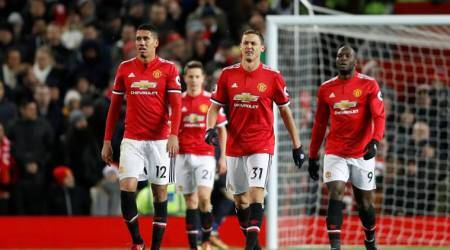 Manchester United players look dejected after conceding second goal against Manchester City in Premier League