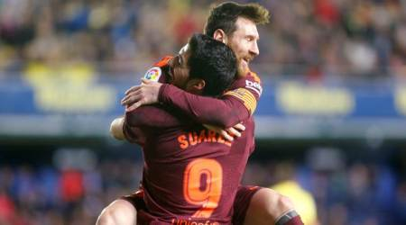 Barcelona's Lionel Messi, Luis Suarez strike after Villarreal reduced to 10 men