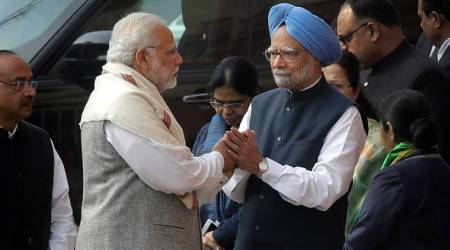 After bitter Gujarat campaign, PM Modi shakes hands with Manmohan Singh in Rajya Sabha
