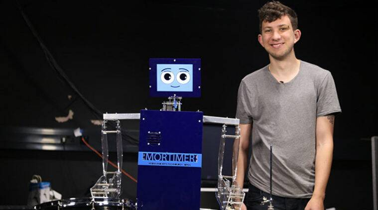 Drumming robot, Mortimer drums, Queen Mary University of London, Facebook friends, music compositions, social media, human pianists, Facebook photos, human-robot relationships, Facebook data