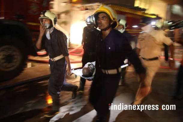 mumbai fire, mumbai fire photos, london taxi bar fire, mumbai bar fire images, lower parel fire pictures, mumbai taxi bar fire pics, mumbai fire latest pics, kamala hills fire photos, indian express