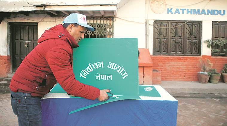 An election official sets up a polling booth in Kathmandu Wednesday