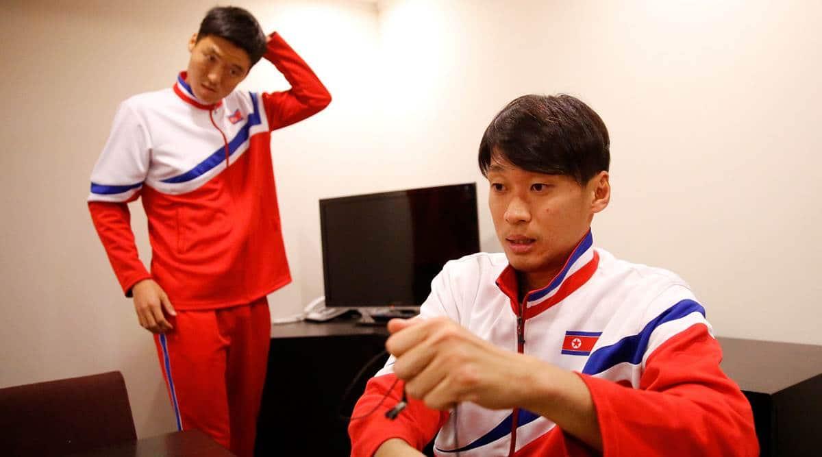 North Korea's national football team players Kim Song Gi (L) and Lee Yong Jick