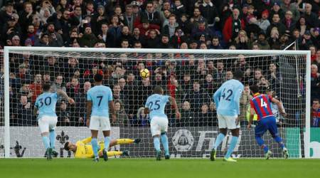 Ederson penalty save preserves Manchester City's unbeatenrecord
