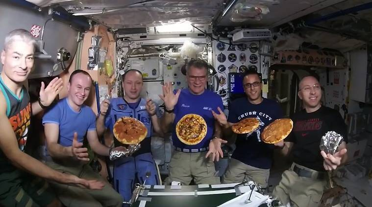 See astronauts throw a pizza party in space