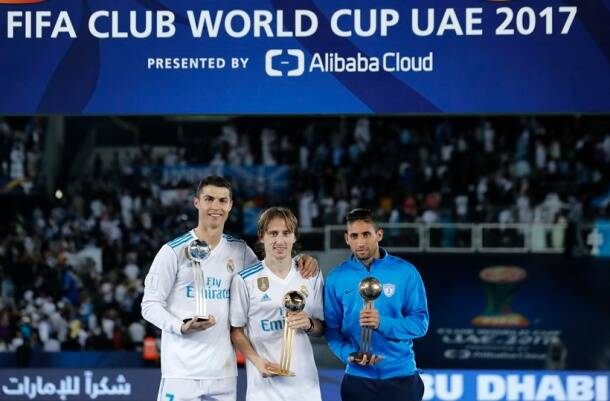 Cristiano Ronaldo, Luka Modric and Jonathan Urretaviscay with respective trophies after Club World Cup