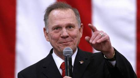 Republican Roy Moore embraces Donald Trump message on eve of Alabama election