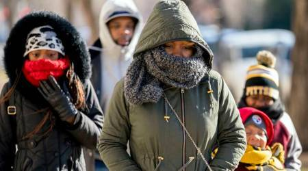 As deep freeze sets in east coast of US, people urged to help mostvulnerable