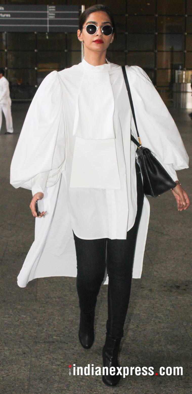 Sonam Kapoor in a balloon-sleeved, high-low white tunic.