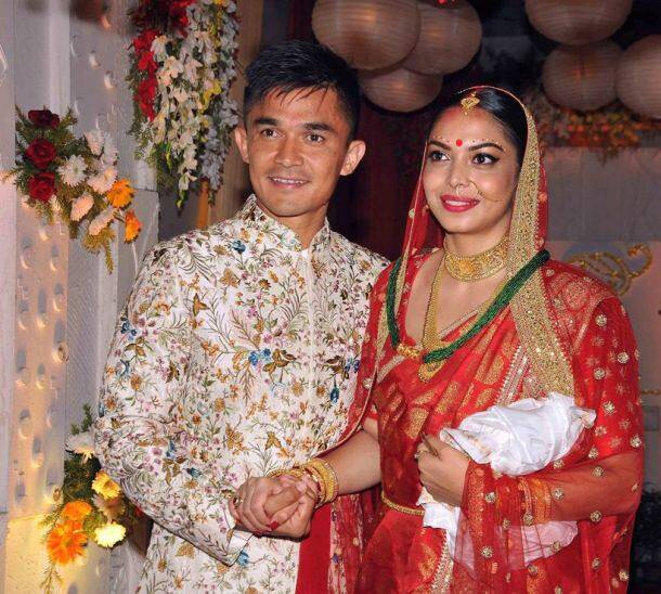Indian football captain Sunil Chhetri with his wife Sonam posing after their wedding