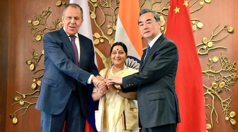 Hope india will find a way to benefit from chinas bri russia the sushma swaraj with chinese foreign minister wang yi r and russian foreign minister sergey lavrov source twitter m4hsunfo