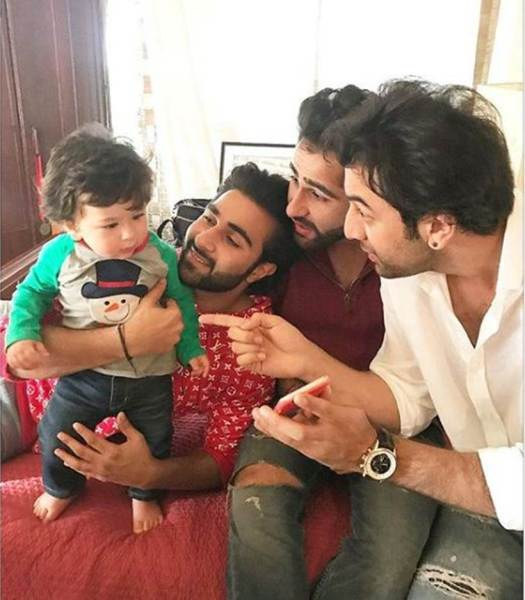 taimur plays with uncles Ranbir kapoor and aadar jain