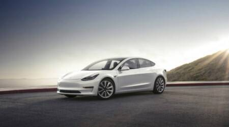 Chevron economist, waiting for Tesla Model 3, says oil cos unfazed by electriccars