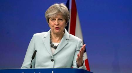 Theresa May promises to uphold Northern Ireland peace process as Brexit impasse ends