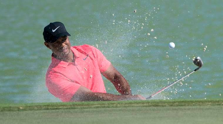 Smiling Tiger Woods ties for ninth as Rickie Fowler wins with 61 in Bahamas