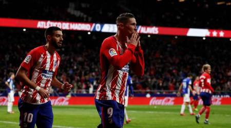 Fernando Torres strike sees Atletico Madrid go second after Valencia lose