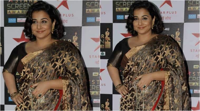 Vidya Balan drapes a golden Raw Mango sari at the Star Screen Awards.