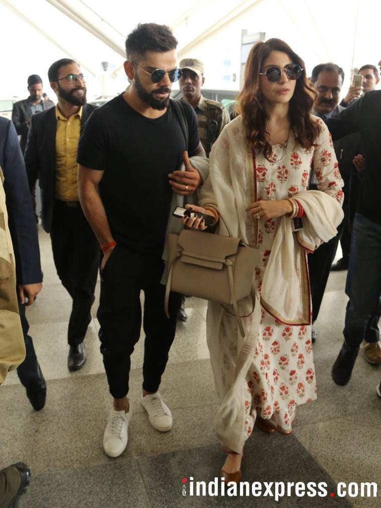 photos of virat kohli and anushka sharma at delhi airport