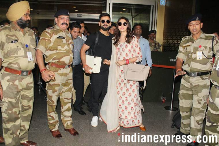 photos of anushka sharma and virat kohli from airport