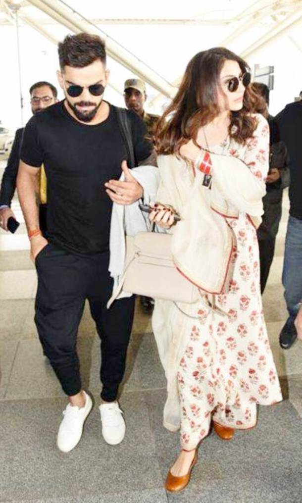 Virat Kohli, Anushka Sharma head to Mumbai after wedding reception, see pics