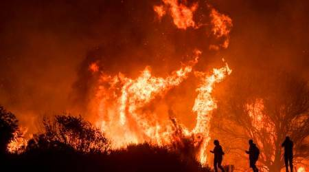 Firefighters battle intense wildfires ravaging southernCalifornia