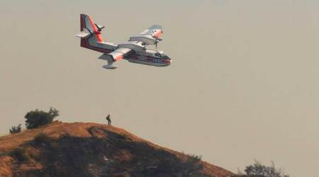 California wildfire fight aided by better weather after two weeks