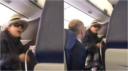 VIDEO: Woman threatens to KILL everyone in flight after she is stopped from smoking