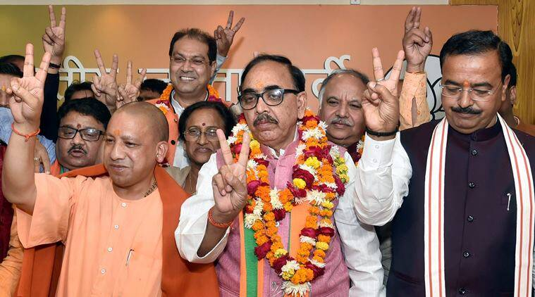 CM Yogi Adityanath, his deputy Keshav Prasad Maurya and BJP state president Mahendra Nath Pandey celebrate the victory of the party in the state civic body elections