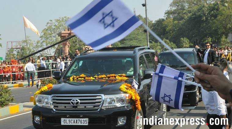 Prime Minister Narendra Modi with Israeli Prime Minister Benjamin Netanyahu and his Wife Sara during road show in Ahmedabad on Wednesday.