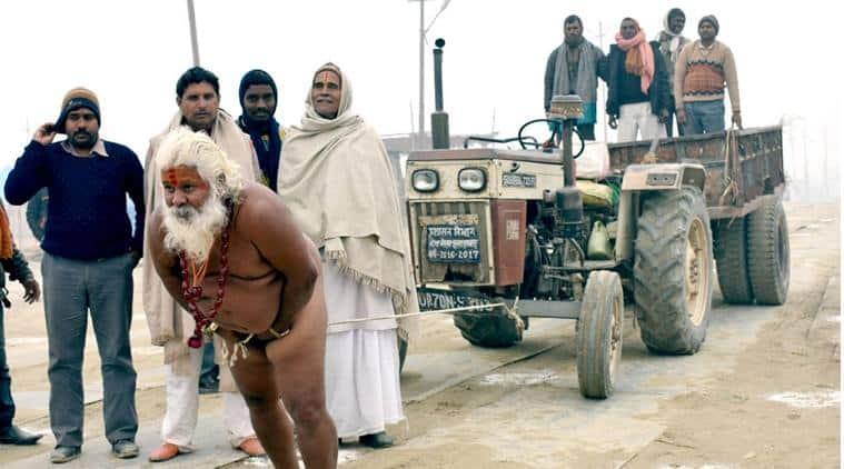 magh mela, allahabad magh mela, sadhu pull truck with penis, penis weight lifting, penis truck pulling, allahabad news, up news, india news, odd news, bizarre news