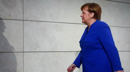 German lawmakers elect weakened Merkel to fourth term