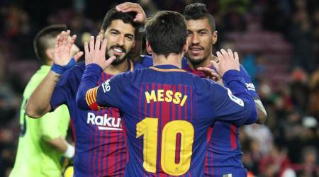 Lionel Messi, Luiz Suarez and Paulinho on target in routine Barcelona win