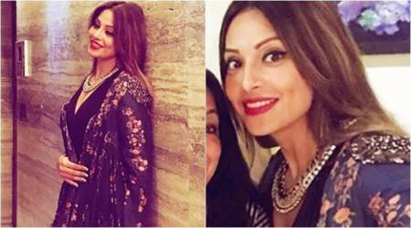 Bipasha Basu adds some desi glam to her black dress with this floral cape