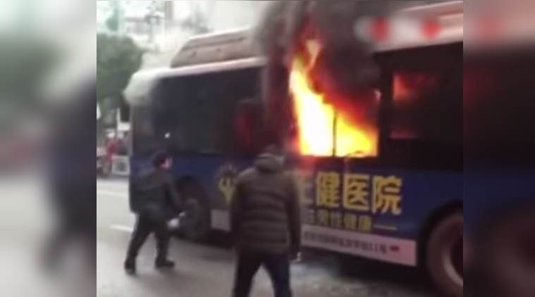 accident video, bus caught fire video, man saving passenger from burning bus video, viral video of passenger being saved, indian express, indian express news
