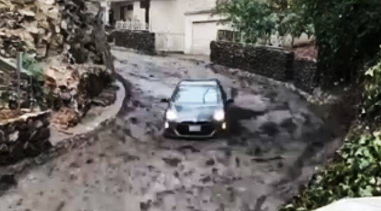 Mudslide sends Toyota Prius sliding down hill