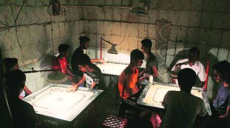 Common cause: In slum lanes, young & old relax overcarrom