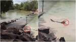 Video of a croc lunging for a fisherman's catch at a dangerous Australian water crossing goes viral